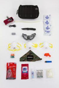 Top View of Emergency Survival Kit Every Day Carry - Ready To Go Survival on white background
