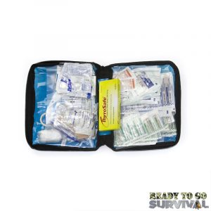 Opened First Aid Only first aid kit on white background