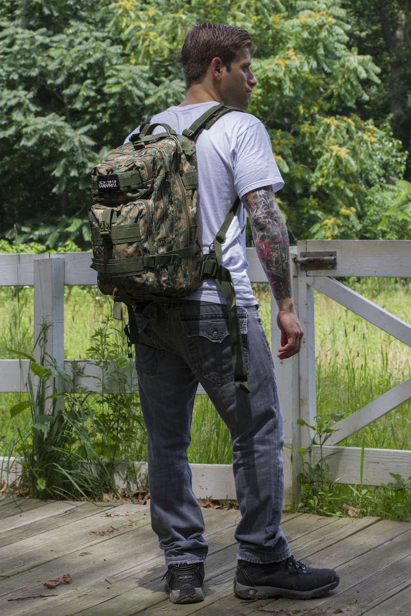 Male model with his back facing the camera, wearing a tactical traveler survival kit from Ready To Go Survival