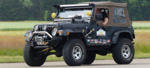 Jeep with a fully loaded car survival kit